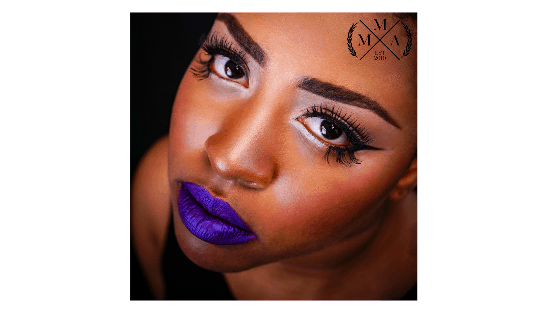 Slick, graphic eyeliner. Full lashes and colorful lip.